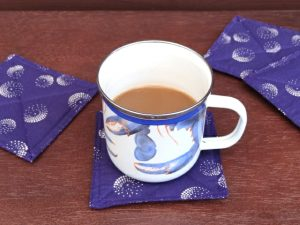 Purple coasters with blue crab enamel mug