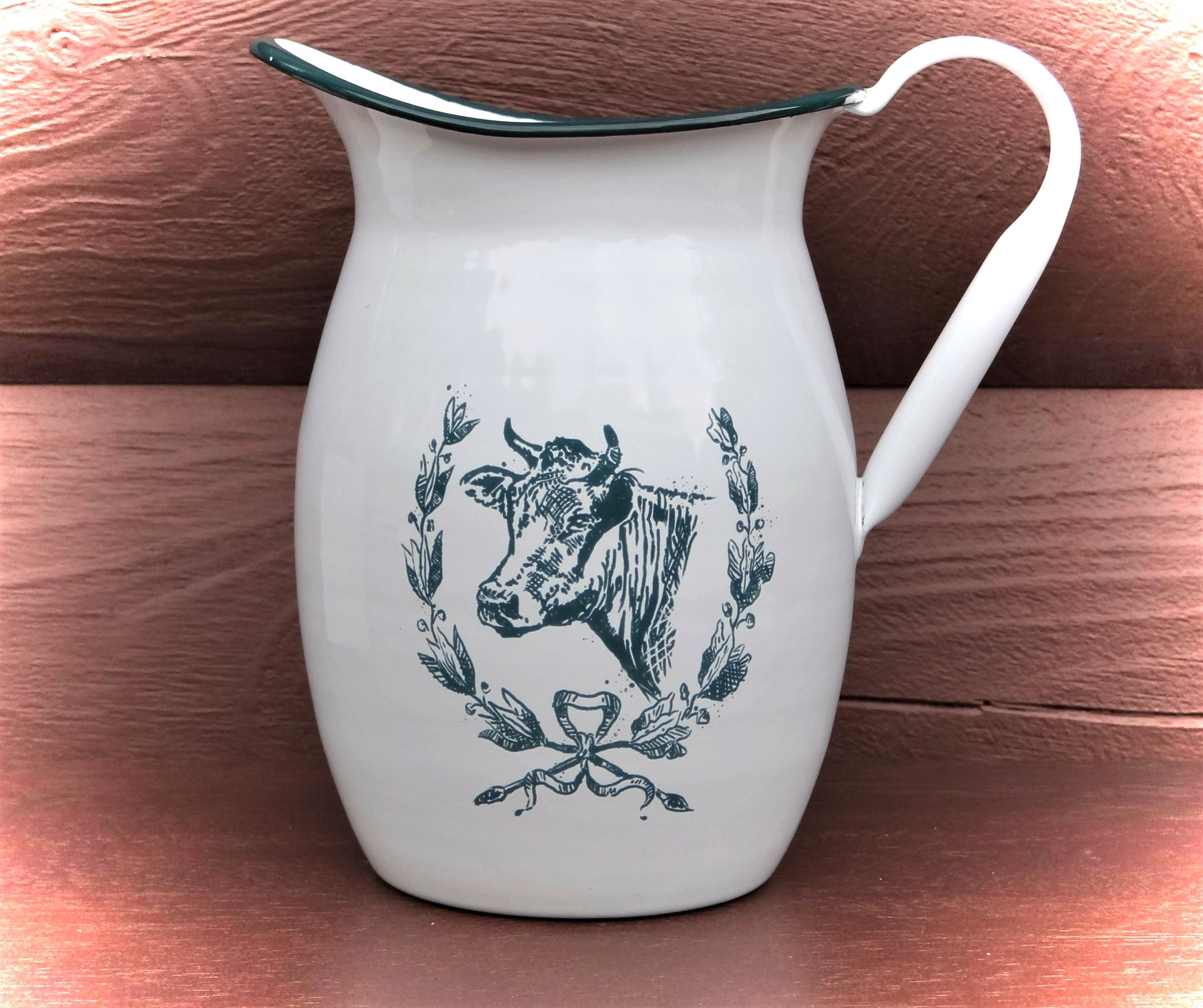 White enamel water/milk pitcher.